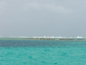 Caribbean sea with reef in distance